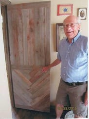 Garry Anderson shows the entry door into his house