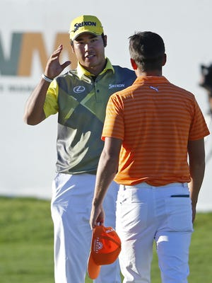 Hideki Matsuyama is greeted by Rickie Fowler after his fourth playoff hole win during the final round of the Waste Management Phoenix Open golf tournament at TPC Scottsdale in Scottsdale, Az., on Sunday, February 7, 2016.