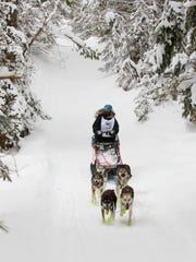 Hannah Mahoney racing her four dogs during the 2017 Tahquamenon Country Sleddog Race on January 7, 2017 at Muskallonge Lake State Park in Michigan's Upper Peninsula.
