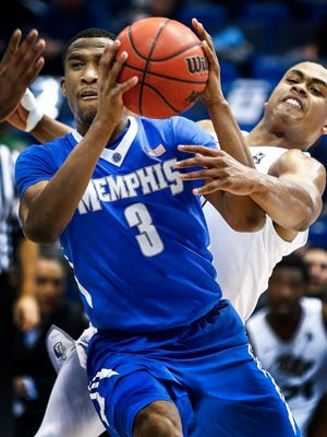 University of Memphis guard Jeremiah Martin (left) is fouled by Central Florida  defender B.J. Taylor during first-half action of their second round American Athletic Conference tournament game in Hartford, Conn.