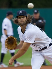 Tigers pitcher Daniel Norris warms up before the start