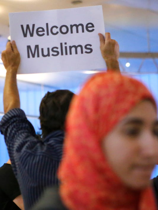 A new fight as Trump's travel ban takes effect