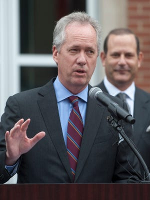 Louisville Mayor Greg Fischer speaks at a ribbon-cutting ceremony for its two new buildings at 656-658 S. 4th Street. Behind him is Kindred Healthcare CEO and President Ben Breier on Thursday, Jan. 11, 2018.