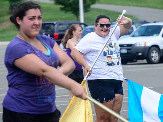 Guard section leader and Vestal senior Molly Merges, left, works with the rest of her section during band camp for the Vestal Marching Band.
