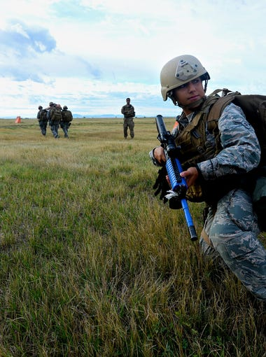 Prospective members of the tactical response force perform a drill involving the transport of a casualty during tryouts on Sept. 20, 2016 at Malmstrom Air Force Base. TRF responds to a range of threats including those at nuclear missile sites.