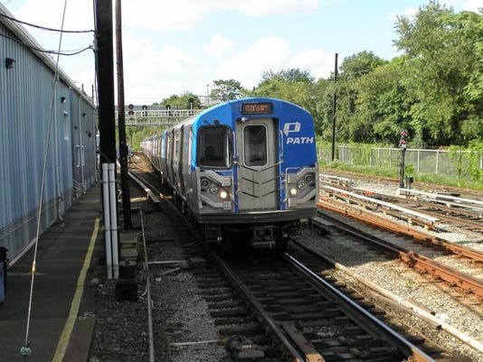 New PATH PA-5's approach Jersey City tunnel to grove Street station.jpg