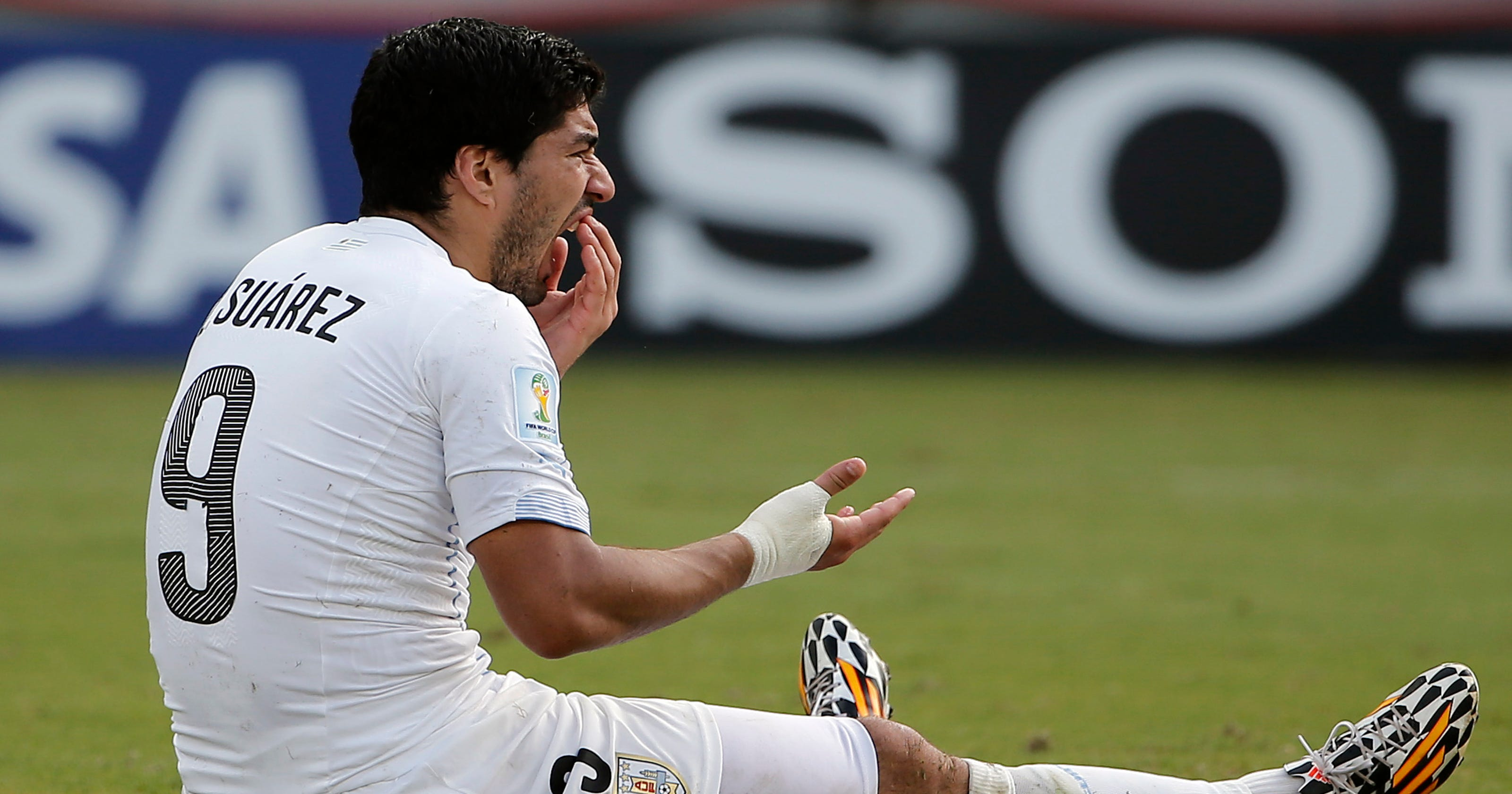 cad3cfb644c FIFA charges Luis Suarez for biting incident