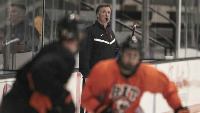 RIT head coach Wayne Wilson keeps close watch on the action during their practice Wednesday, Oct. 8, 2014 at the Polisseni Center at RIT in Henrietta.