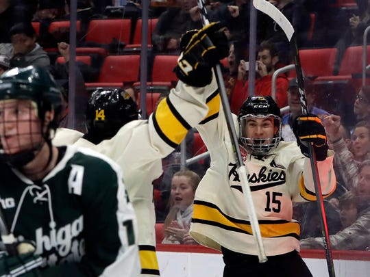 Michigan Tech forward Jake Lucchini (15) reacts after