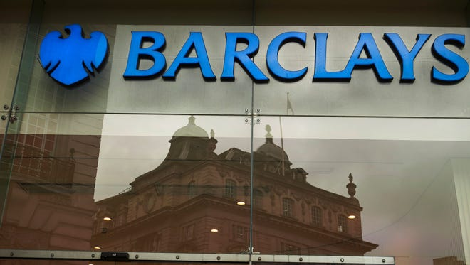 This file photo taken in 2015 shows a logo of British bank Barclays on a sign outside one of the bank's branches in London.