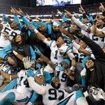 Some Carolina Panthers celebrate from the bench during the second half the NFL football NFC Championship game against the Arizona Cardinals, Sunday, Jan. 24, 2016, in Charlotte, N.C.