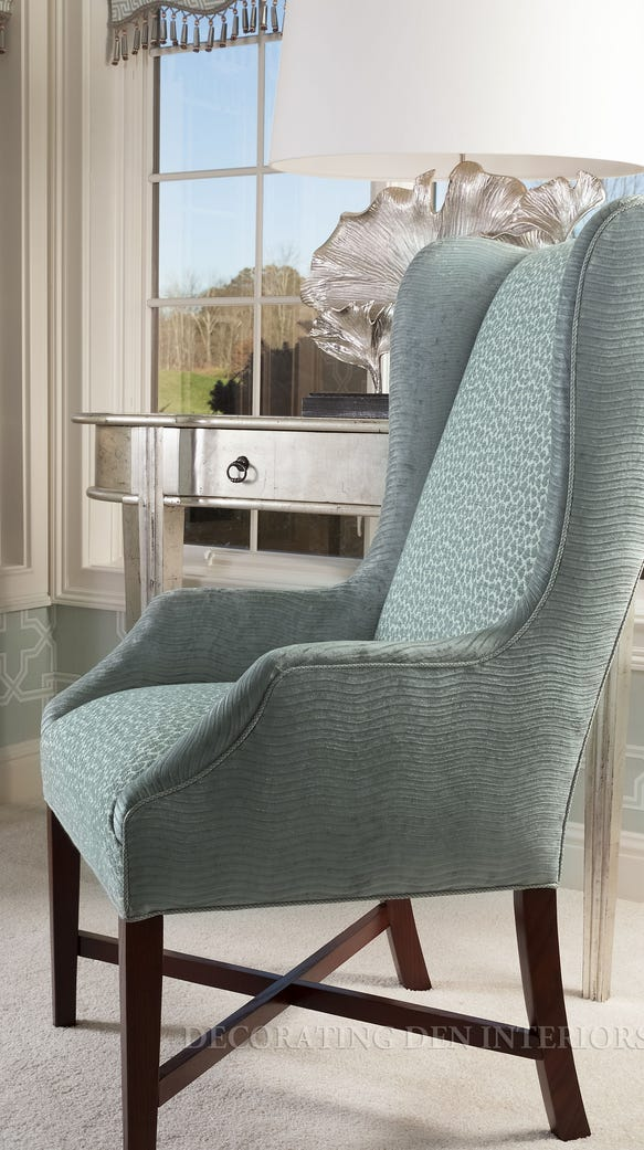 A pair of wing chairs was re-upholstered to match the