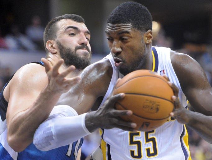 Roy Hibbert goes to the basket against Nikola Pekovic of the Timberwolves. The Pacers hosted the Minnesota Timberwolves in NBA action Monday November 25, 2013 at Bankers Life Fieldhouse.