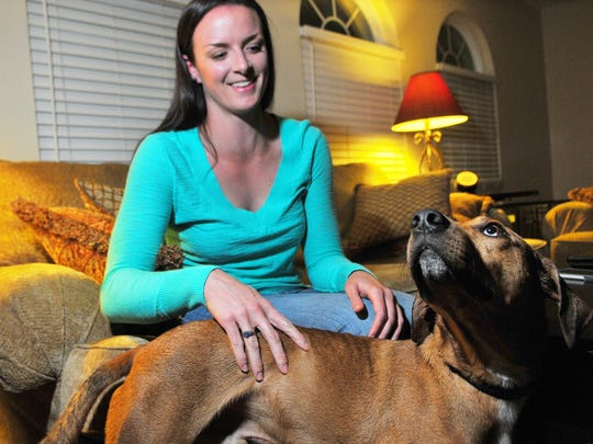 Jessica Dent, of Indian Harbour Beach, pets her dog Kai. Dent purchased her first home after renting for the past eight years.