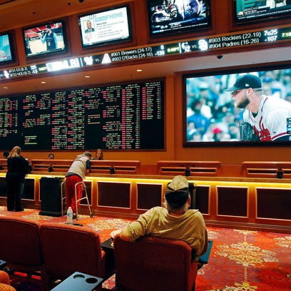 People make bets in the sports book at the South Point