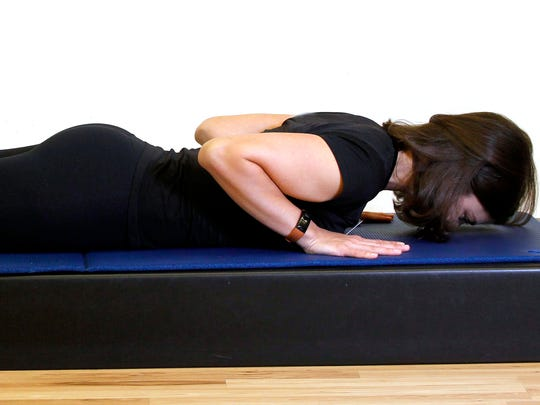 Erin Stern shows the starting position for the Pilates exercise, back extension.