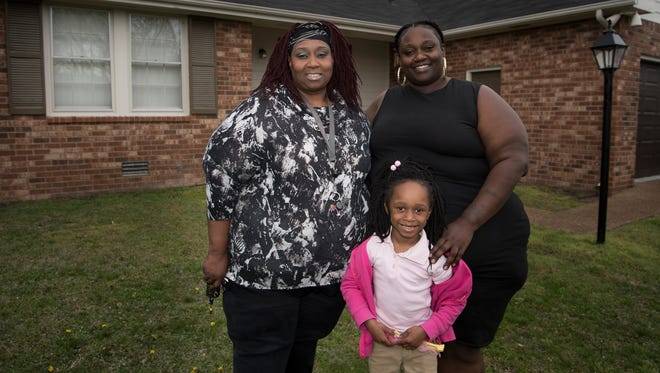 Denise Ragland, left, with her granddaughter Mercedes Bonds, 5, and her daughter Alexis Stamper, are looking forward to living in their new home in the Madison neighborhood.