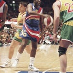In this Feb. 13, 1993, file photo, legendary Harlem Globetrotters' Meadowlark Lemon prepares to put the moves on Washington Generals' Tim Burkhart during their basketball game at Madison Square Garden.