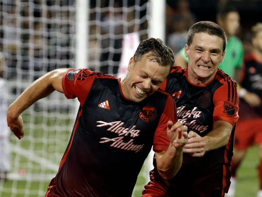 Portland Timbers defender Jack Jewsbury, left, celebrates his goal during extended play with teammate Will Johnson in an MLS soccer game against the San Jose Earthquakes in Portland, Ore., Sunday, July 5, 2015.  The Timbers won 1-0. (AP Photo/Don Ryan)