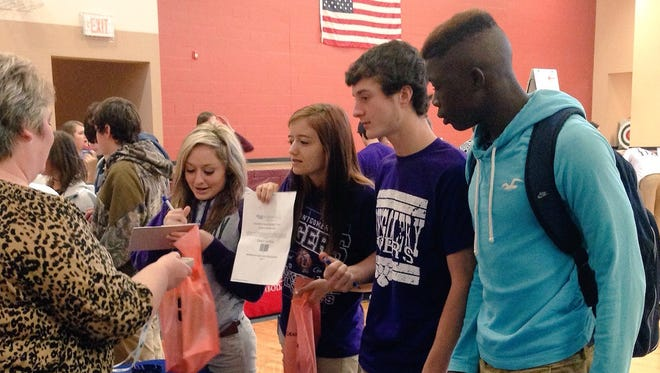 Renee Melder (left), association director of enrollment management at Louisiana College, talks with Montgomery High juniors (from left) Rayven Kuhlmann, Caitlyn Lemoine, Shaine Ferrier and D'Mycal Turner at a Grant Parish college and career fair on Monday.