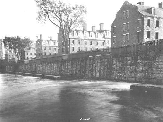 Eastern Canal by the Boott Mills Boardinghouse in Lowell, Mass. As part of life in Lowell, mill girls were required to live in company-owned boardinghouses.