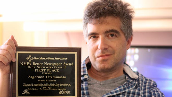 Headlight Reporter Algernon D'Ammassa earned the top award for column writing from the New Mexico Press Association's Better Newspaper Contest.
