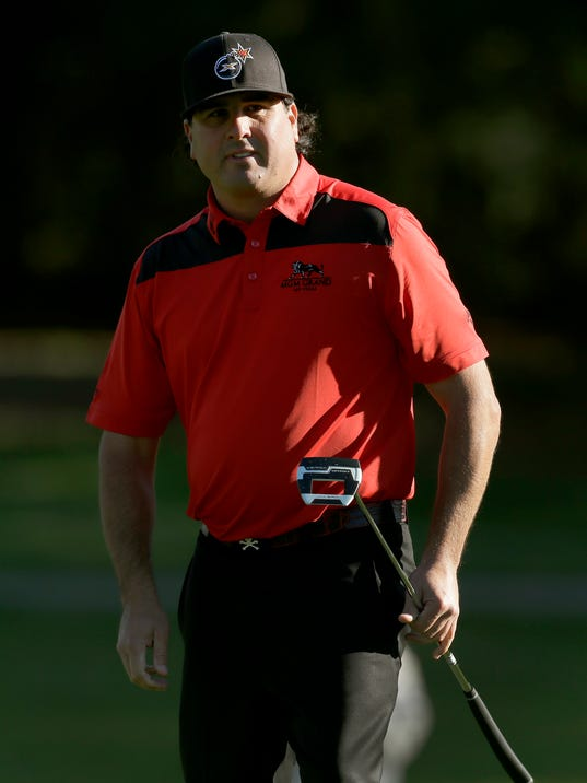 Pat Perez watches his putt roll past the hole on the seventh green during the second round of the Valspar Championship golf tournament at Innisbrook Friday, March 14, 2014, in Palm Harbor, Fla. (AP Photo/Chris O'Meara)