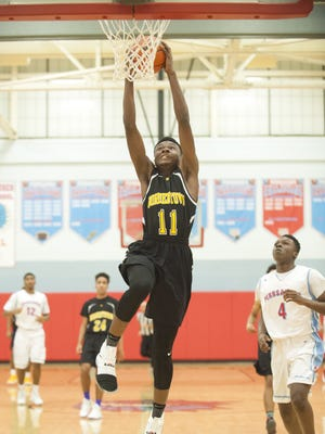Bordentown's Manny Ansong goes up for a dunk in the first quarter of Tuesday's Burlington County League game against Pennsauken.