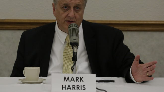 Democrat Mark Harris, running for the 18th Senate District, answers a question during the Oshkosh Chamber of Commerce debate Wednesday, Oct. 26, 2016, held at LaSure's Banquet Hall.