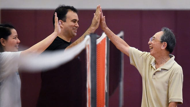 James Ho, 86, is all smiles as he congratulates another team that beat him in a badminton match.One of most multi-cultural sports in Nashville may surprise you-badminton  Thursday Sept. 22, 2016, in Nashville, Tenn.