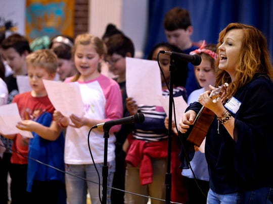 Carla Heard, with the songwriter's group The Beat of Life sings and plays a song written by the group and the 5th grade class at Homer Pittard Camps School, in Murfreesboro on Monday, April 2, 2018, during a live performance.