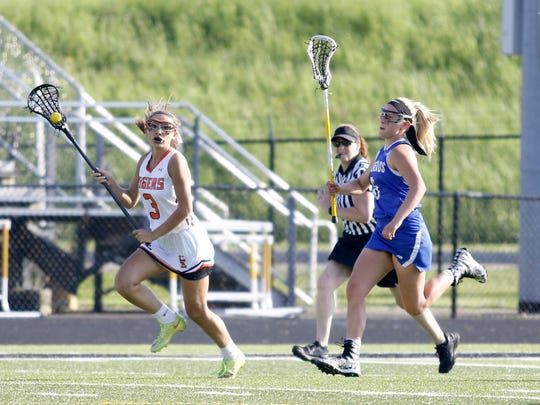 Melina Forconi of Union-Endicott runs up the field with the ball as Sidnie Decker of Horseheads gives chase May 23 during the Section 4 Class B girls lacrosse final at Corning Memorial Stadium.