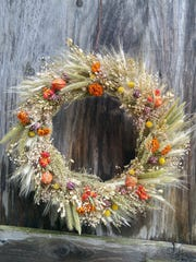 This dried wreath includes dried grasses, gypsophelia