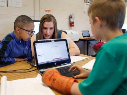 Third grade teacher Joyce Burns helps Mozes Lovett with his research project as Joie Herndon, right, works in the library on Thursday, Apr. 28, 2016 at William Elementary.