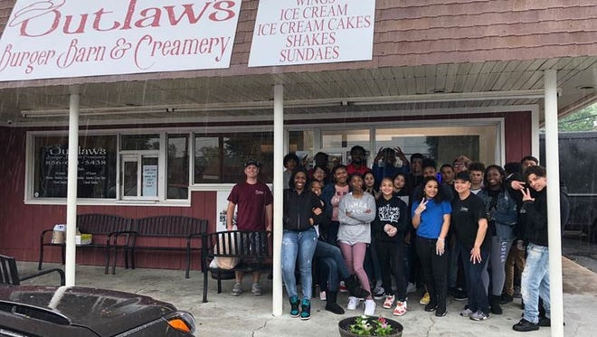 Students and staff from Cunningham Academy joined forces with Ryan Briggs, owner of Outlaws Burger Barn and Creamery, for a day of service.