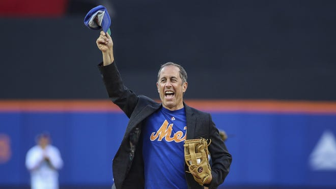 Jul 5, 2019; New York City, NY, USA; Comedian Jerry Seinfeld throws out the ceremonial first pitch prior to the start of the Philadelphia Phillies and New York Mets game at Citi Field. Mandatory Credit: Wendell Cruz-USA TODAY Sports ORG XMIT: USATSI-398771 ORIG FILE ID:  20190705_ggw_cc1_029.JPG