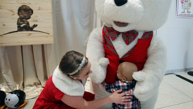 November 23, 2015 - Nineteen-month-old St. Jude Patient Colton Kelley gets a warm embrace from a massive teddy bear with help from Westfield Merry Maker Katt Weston following a holiday themed performance by the singing and dance troupe. In addition to performing for patients and their families in the lobby of St. Jude Children's Research hospital the organization donated $25,000 to the hospital.
