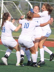 Marian junior Annie Bruce (11) is hugged by her Mustangs