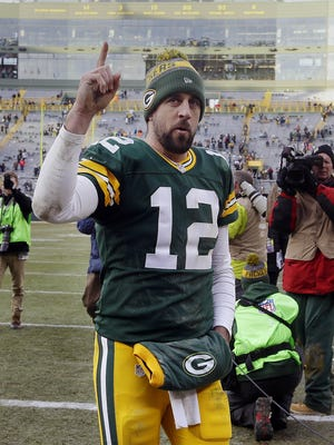 Aaron Rodgers acknowledges fans afterthe Green Bay Packers' 38-25 win over the Minnesota Vikings at Lambeau Field.