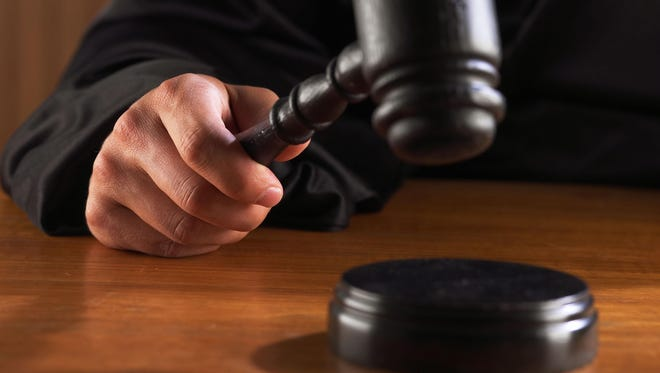 Judge hitting gavel.