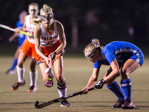 Palmyra's Jess Dembrowski flips the ball over the stick