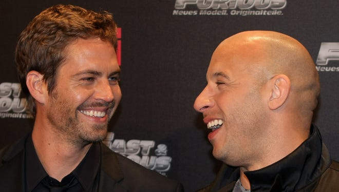 Paul Walker (L) and Vin Diesael arrive for the Europe premiere of Fast & Furious on March 17, 2009 in Bochum, Germany.