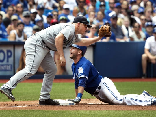 Toronto Blue Jays' Josh Thole, right, is safe at third base as Seattle Mariners Kyle Seager is late with the tag during the sixth inning of a baseball game in Toronto, Sunday, July 24, 2016. (Fred Thornhill/The Canadian Press via AP)