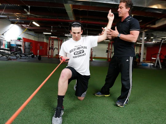 Rockland Community College baseball pitcher Dan Wirchansky, 18, works out with Nunzio Signore, owner of Rockland Peak Performance in Sloatsburg on Monday, May 09, 2016.