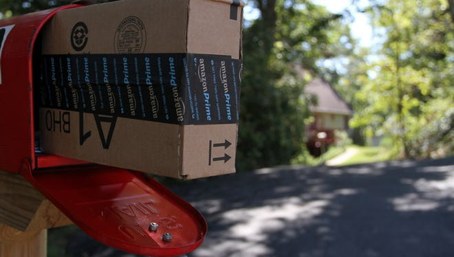 An Amazon Prime package awaits pickup by its customer.