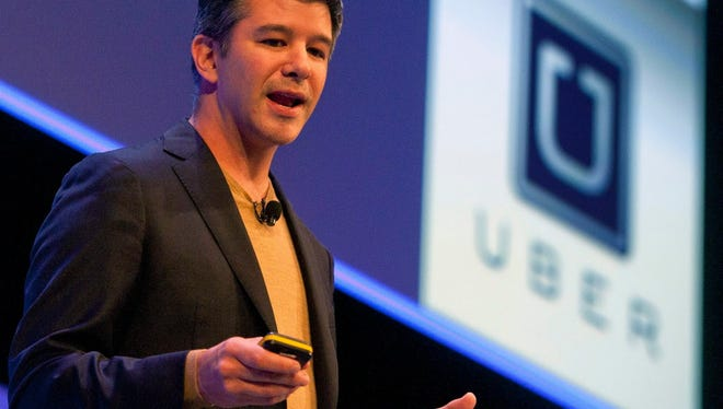 Travis Kalanick, founder and CEO of Uber, speaks at the Institute of Directors Convention at the Royal Albert Hall in London Oct. 3, 2014.