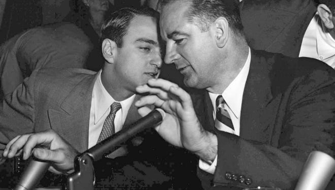 U.S. Sen. Joseph McCarthy, right, speaks to his chief counsel, Roy Cohn, during a hearing of the Senate Investigations Subcommittee in Washington in this April 22, 1954, photo.