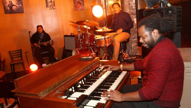 Chicago jazz trio, The DOT (from left to right) Vinnie Rooffe (guitar); Samuel Jewell (drums); and Justin Dillard (B3 organ) perform at Gibraltar.