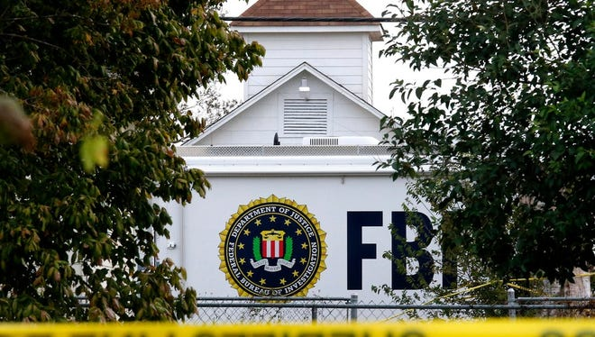 A FBI truck sits in front of the church while investigators worked at the scene of a mass shooting at the First Baptist Church in Sutherland Springs, Tex. The FBI had access to the shooter's cell phone but couldn't access its contents.