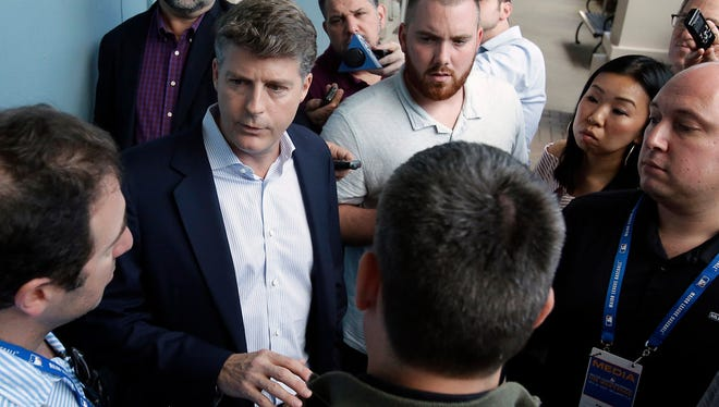 Hal Steinbrenner, principal owner, managing general partner and co-chairman of the New York Yankees talks with reporters at the annual MLB baseball general managers' meetings, Wednesday, Nov. 15, 2017, in Orlando, Fla.